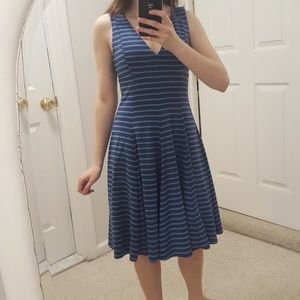 Sleeveless blue striped knee length low cut dress